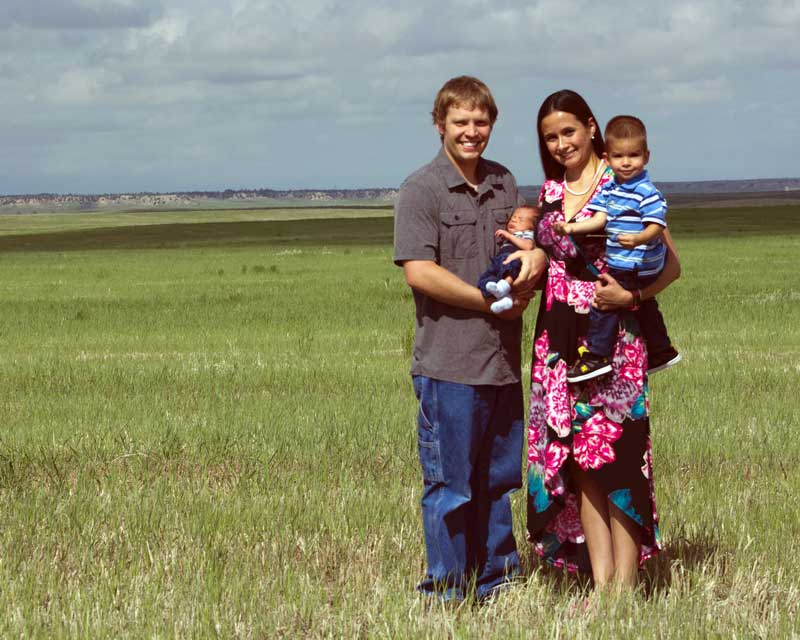 Michaud family in front of the building site of future Wyoming vineyard