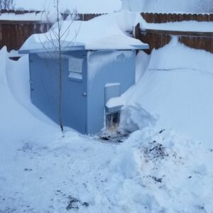 Snow drift covering chicken coop